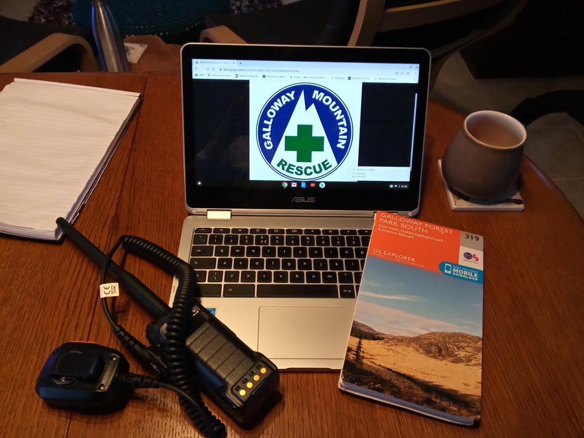 radio, laptop and map